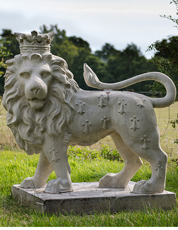 Heraldic Lion looking over left shoulder