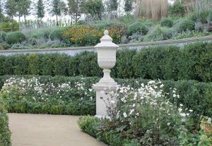 Cast stone coping and pier cap in English garden