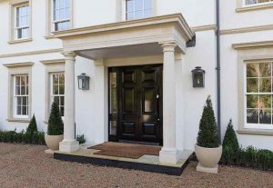 cast stone window sills and portico featured on a new build property in the UK