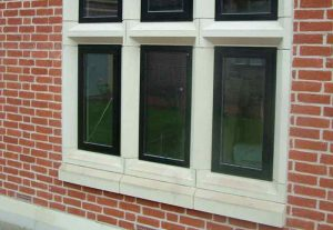 Concrete window sills on red brick house