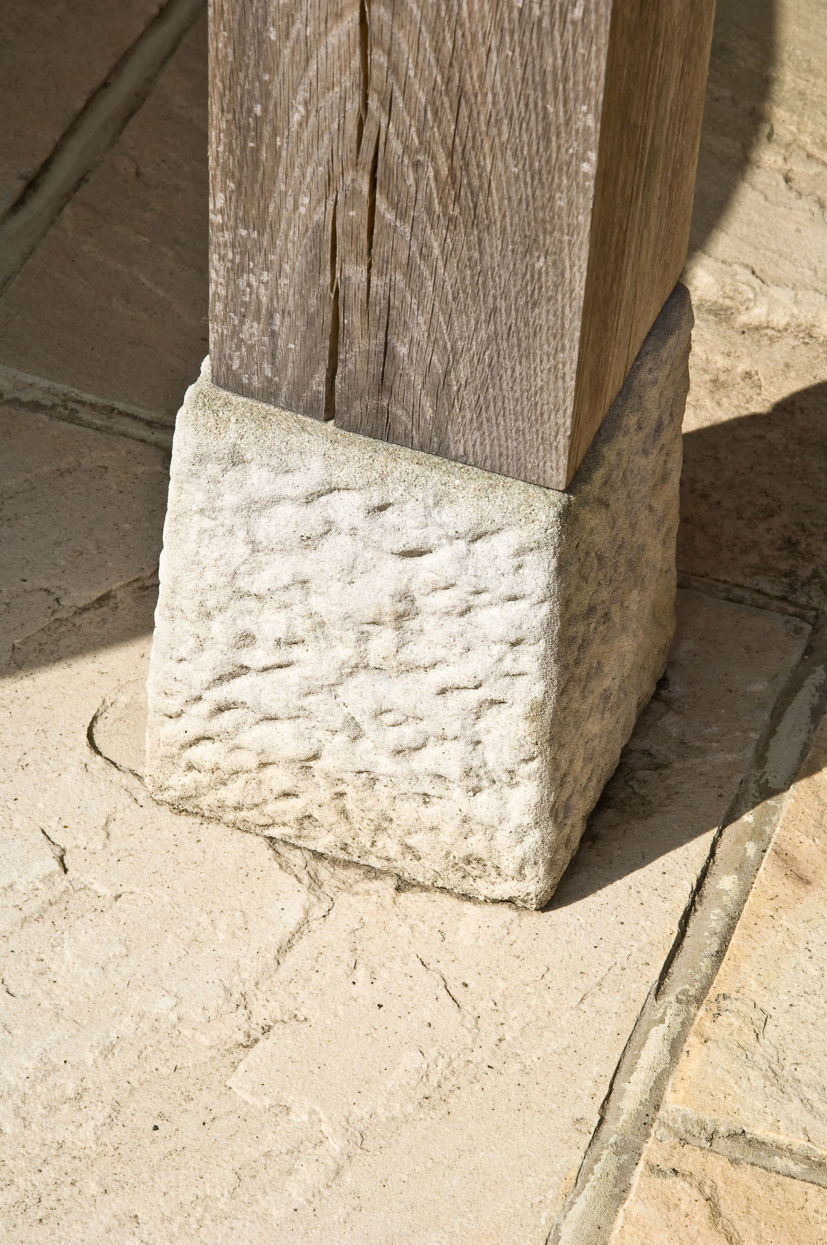 Close up of a Staddle stone on an oak post