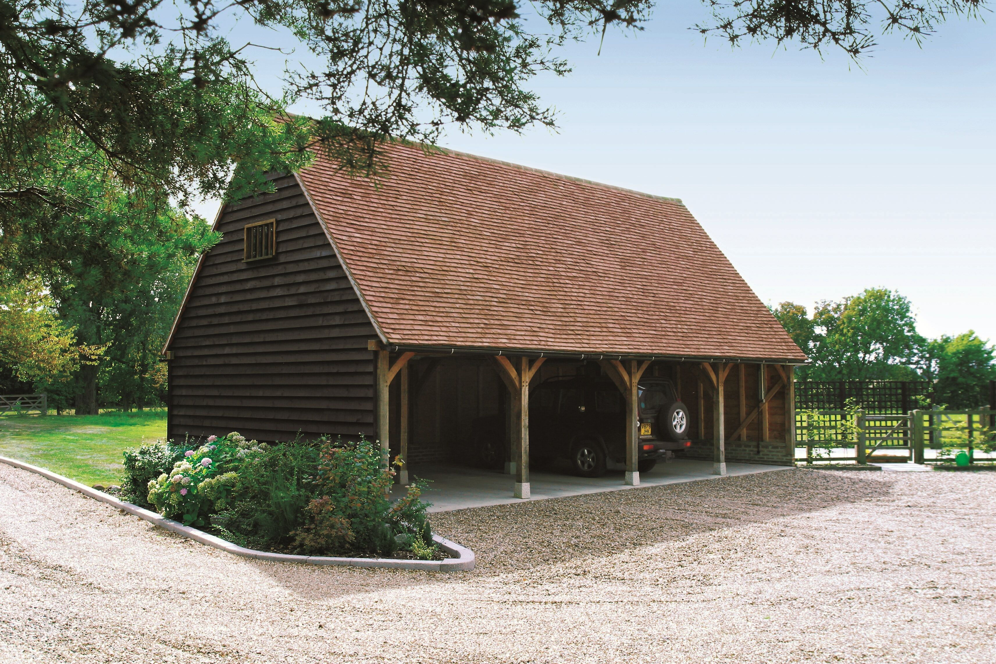 Beautiful timber garage with staddle stones on each post base