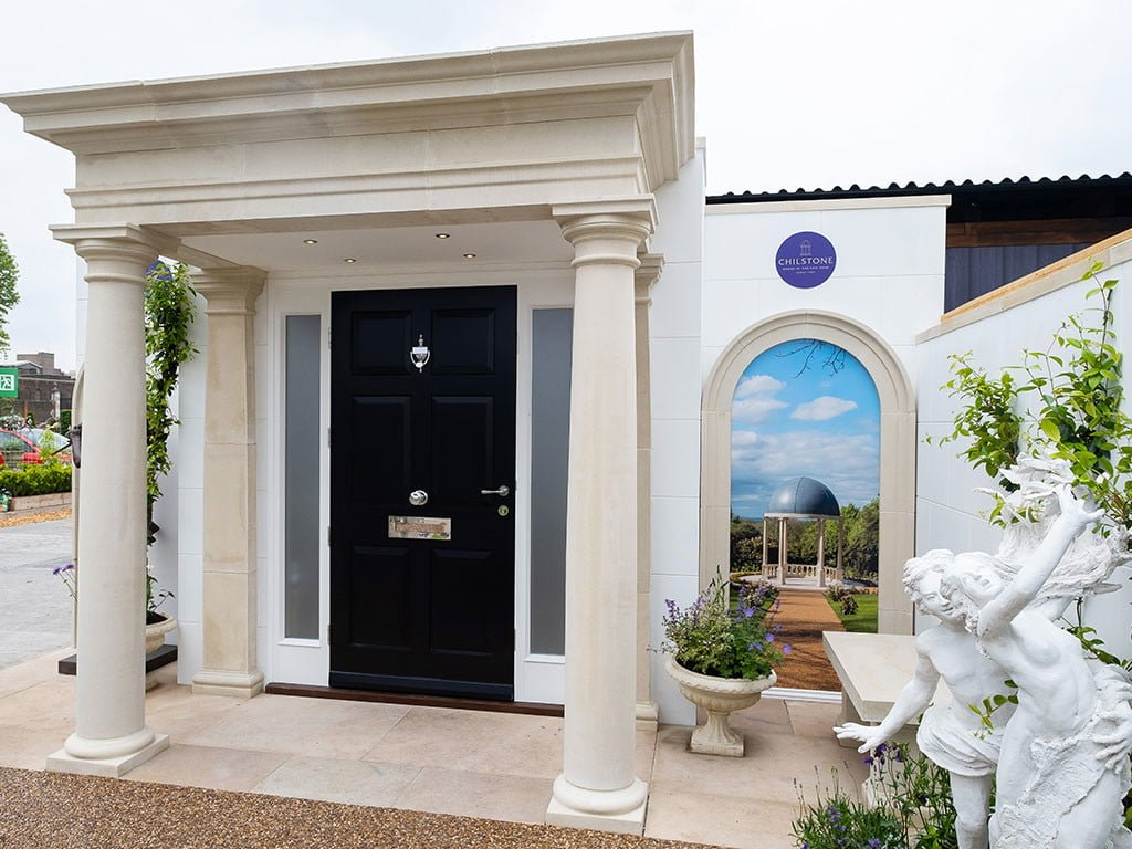 Cast stone portico with black door built for a trade stand at Chelsea