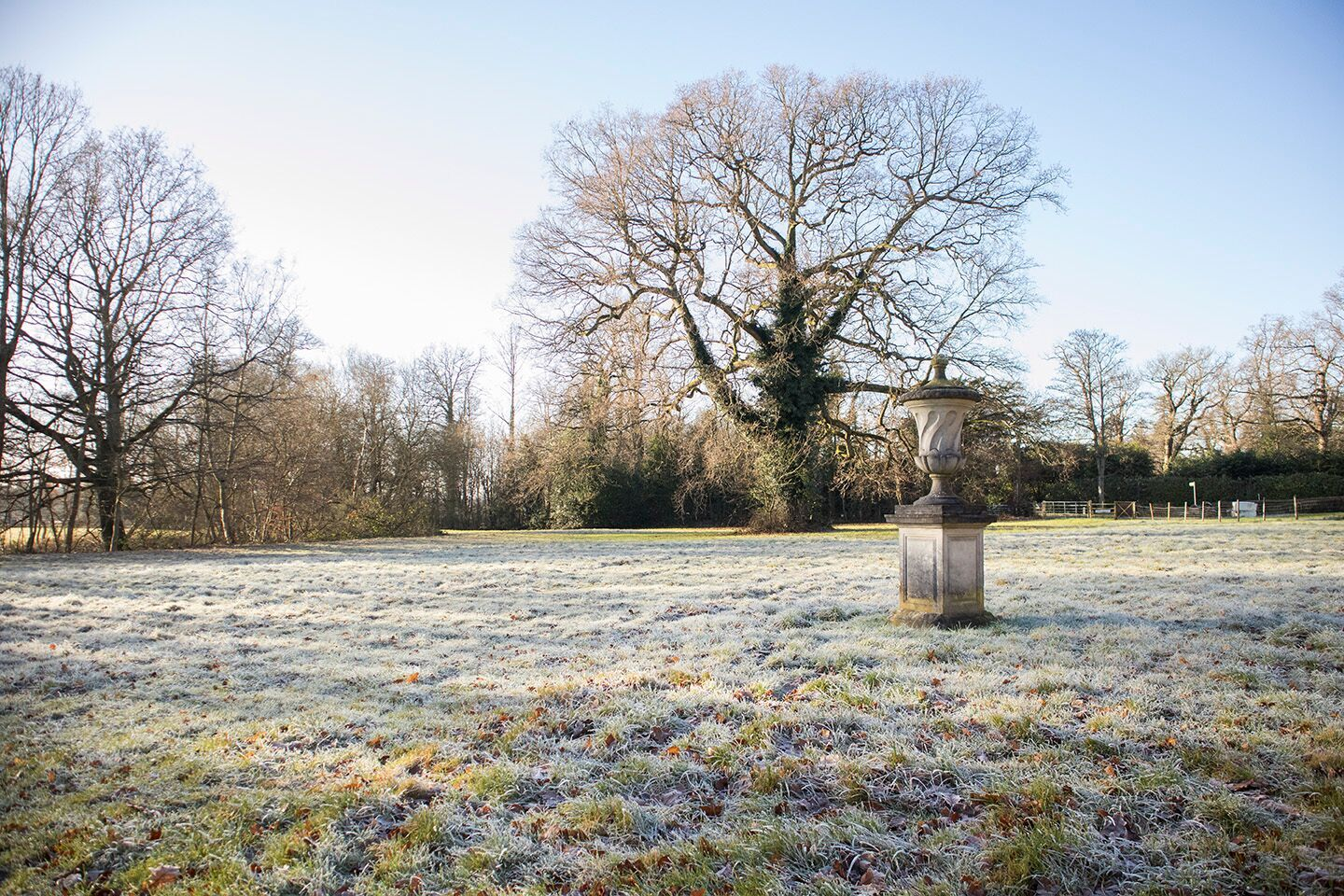 stone urn on a frosty morning in the english countryside