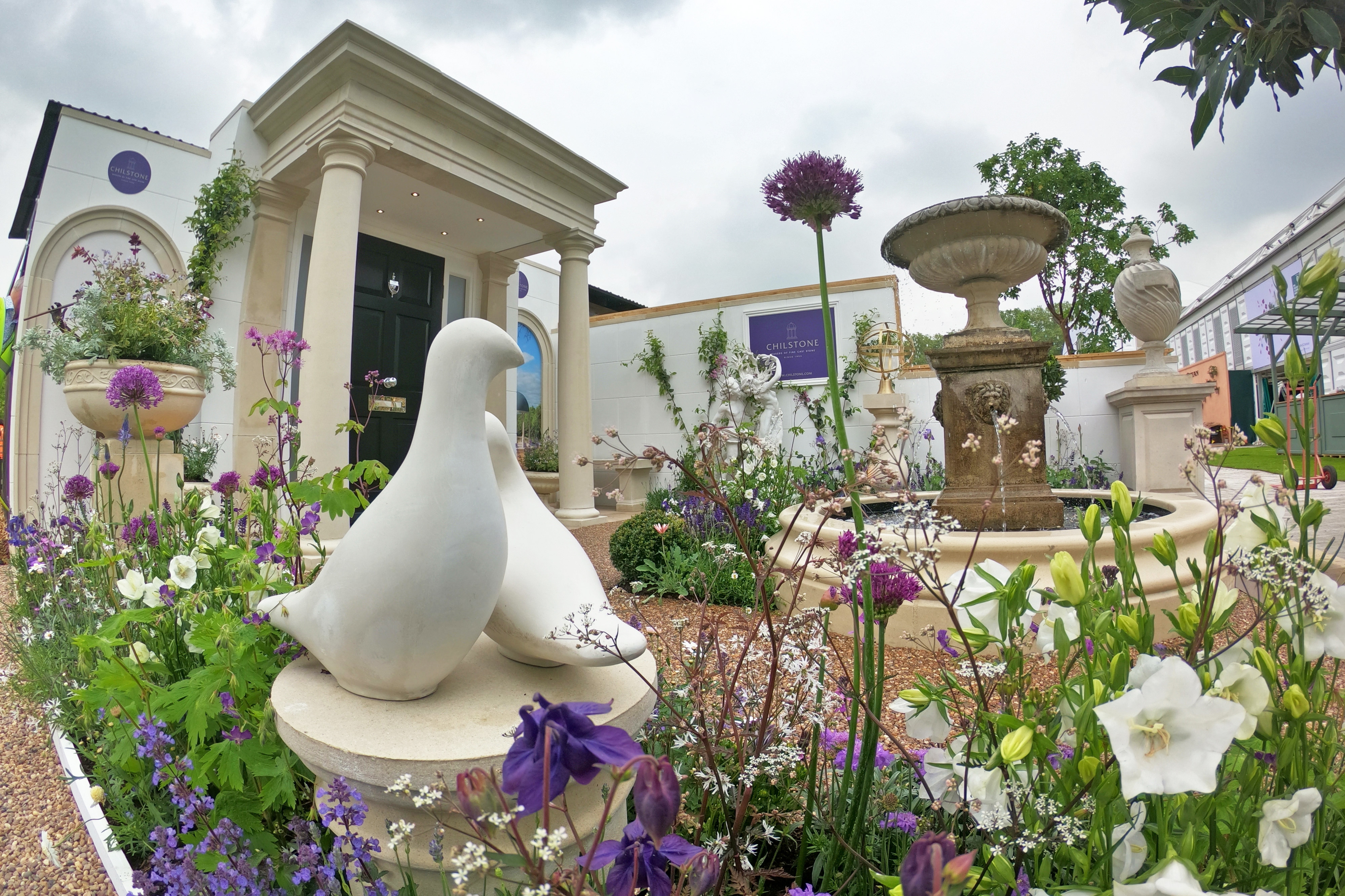 Cast stone dove ornament, fountain and portico featured in RHS Chelsea garden by Chilstone