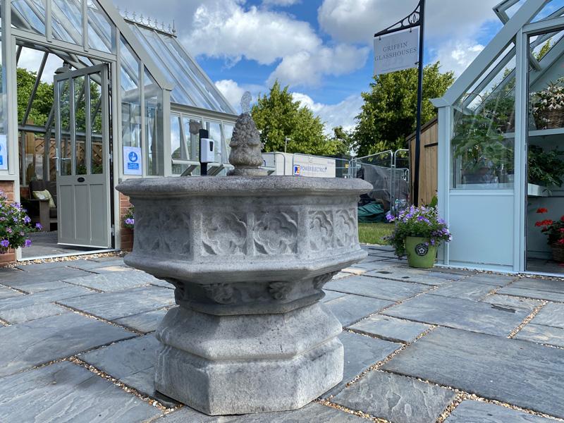 Octagonal fountain in centre of show garden